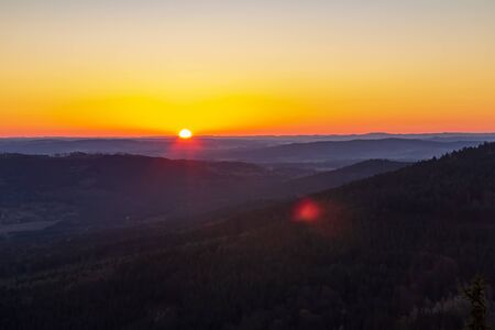 Nice sunrise from Kravi mountain with hill, Czech republic