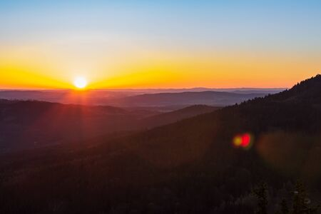 Detail of sunrise from Kravi mountain with hills, Czech republic