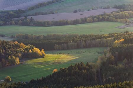 Aerial view to autumn tree and meadow at sunrise from Kravi mountain, Czech republic