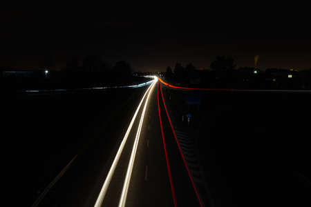 Vehicle car light trails on highway in red and white color. Trafic at night, long exposure Reklamní fotografie
