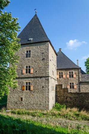 burg: Age castle tower against blue sky and other historic parts of the building