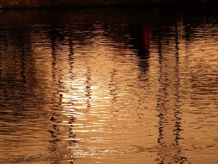 Reflection-water evening sun photo