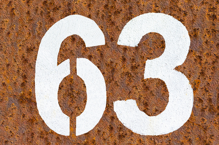 pay wall: Rusty iron background with beautiful structure and number in white paint  Stock Photo