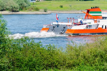 inland waterways: Rear view inland in full speed on the Rhine near Dusseldorf