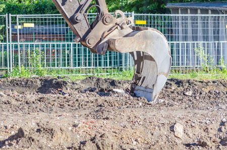 Large excavator shovel in use in earthworks on a building site  photo