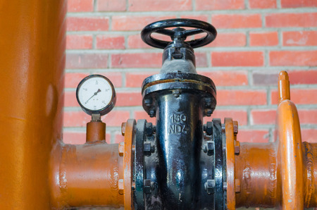 flange: Iron pipe with shutoff valve and flange. Stock Photo