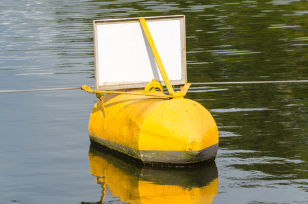 Navaid ton buoy yellow, black indicates a danger point photo