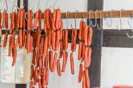 shopping binge: LWL-Open-Air Museum Hagen. Images courtesy of the Department of Public Relations. Traditional food. Smoked sausages hanging on a pole for sale in a butcher shop.