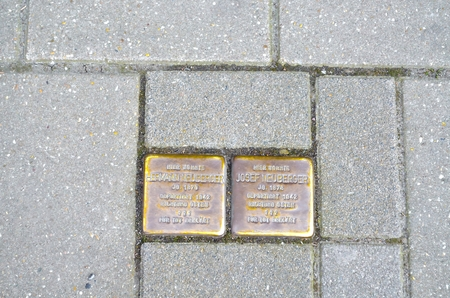 kz: Velbert, North Rhine-Westphalia, Germany - April 1, 2014: Stumbling blocks in the pedestrian zone of Velbert center. Stumbling blocks are memorial plaques to help them remember the fate of the people in the Nazi period. The memorial stones are a project o Editorial