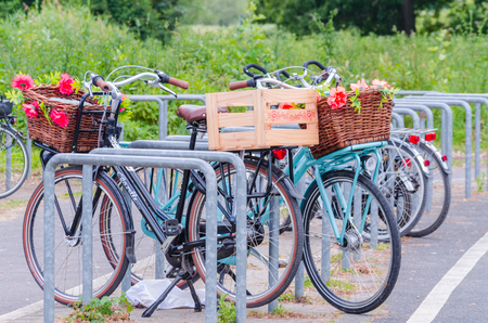 Dssseldorf, Nrw, Germany - June 22, 2014: On the Rhine in Dusseldorf Dusseldorf Kaiserwerth ferry dock. Bicycles are there for advertising purposes for a bicycle hire service. Beautifully decorated with a basket of flowers