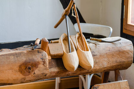 LWL-Open-Air Museum Hagen. Images courtesy of the Department of Public Relations. A pair of traditional wooden shoe socalled clogs.Einzelene manufacturing steps of the traditional wooden shoes called clogs. photo