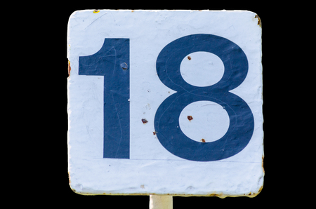 smut: Old dirty white sign with the number 18 number on black background Stock Photo