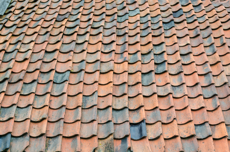 asphalt shingles: Old renovation roof with Equally old roof tiles. Stock Photo