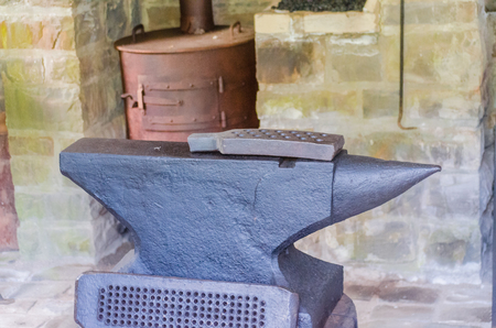 converting: The anvil is a large block made of steel and is for converting and editing mostly glowing metal in a forge used. Stock Photo