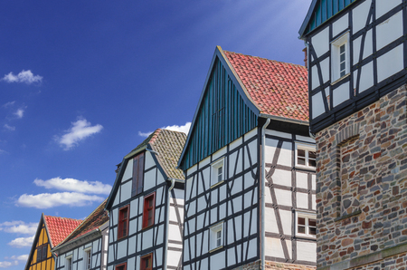urban idyll: Idyllic, gable view of various half-timbered houses against a blue sky.