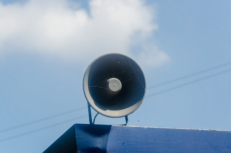 sound system: Old dirty sound system, megaphone on a roof.