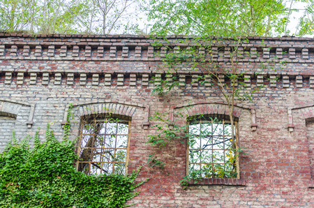Abandoned factory building. Crumbling collapsing brick wall, old mortar joints. Stock Photo