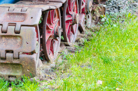 Detail of an old rusty tracks, tanks, chain landing gear. photo