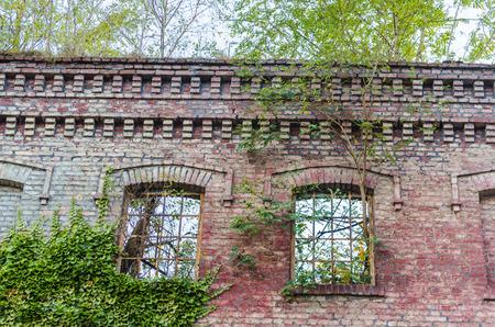 Abandoned factory building. Crumbling Einstürzende brick wall, old mortar joints.
