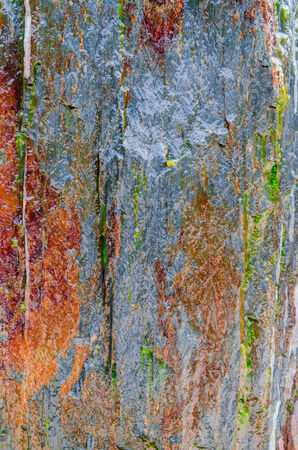 quot: Background of a rough rock wall with brown discoloration. Stock Photo