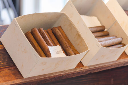 A box full of home-made cigars. Stock Photo