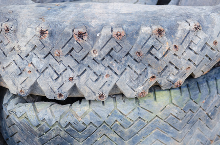 A stack of old studded tires. The use of studded tires is not allowed in Germany. photo