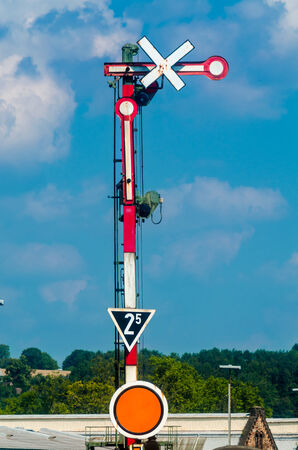 security lights: Red White railway signal against a blue sky. Stock Photo
