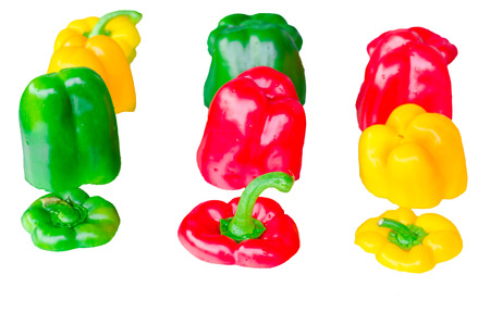 dissemination: Yellow, Red, Green pepper sliced ??isolated against white background.
