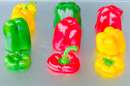 dissemination: Yellow, Red, Green Bell Pepper cut on a silver platter.