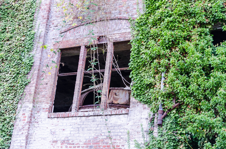 Abandoned factory building. Crumbling Einstrzende brick wall, old mortar joints.