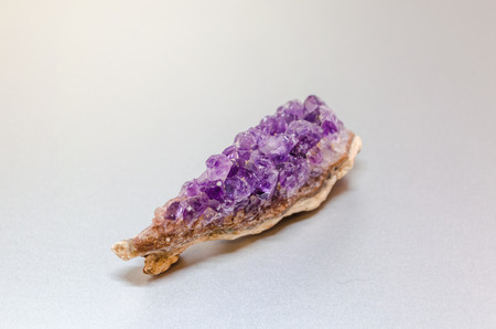 Raw Amethyst crystal. The crystal is a variety of the mineral quartz photo
