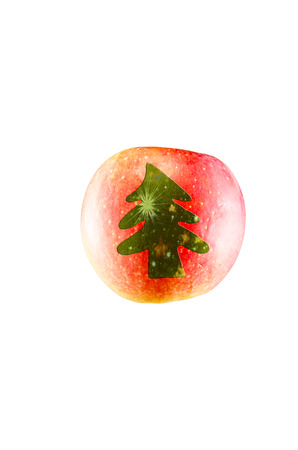 christmas motif: Apple with motif. Red apple with a christmas tree icon. Stock Photo