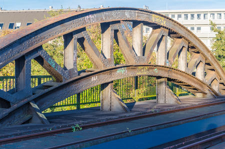 riveted: Riveted old bridge arch.