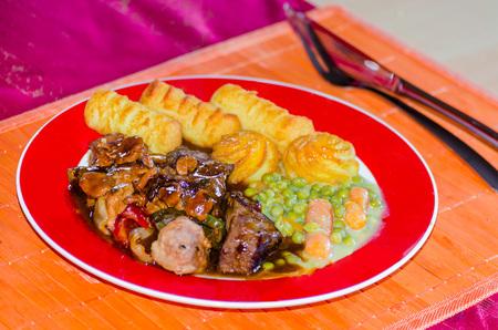 shashlik: Shashlik with croquettes and vegetables.