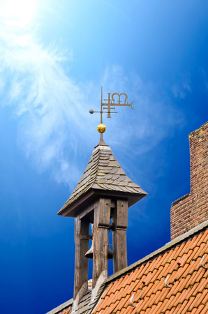 unhindered: Steeple against a dark blue sky.