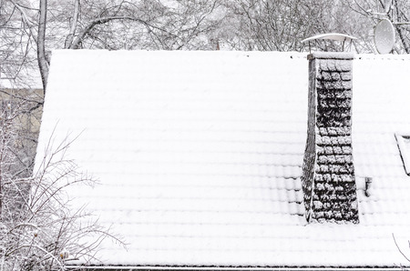 roof windows: Roof snowed in new snow in the morning. Stock Photo