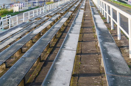 sporting event: Long rows of seats for spectators at a sporting event. Stock Photo