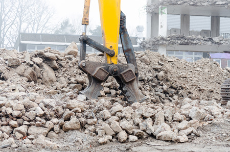 Excavators Crushers is a tool for growing in excavator. To shred of concrete. The force is generated by hydraulic pressure. Stock Photo