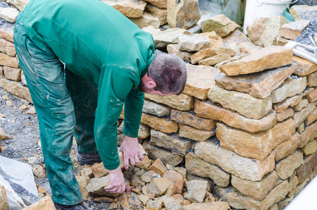 dry stone: Sand stone wall for a raised bed. Create a dry stone wall.