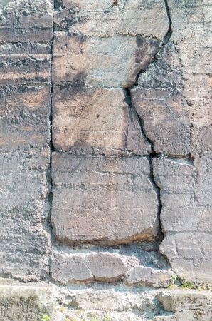 remediation: Damage to a reinforced concrete wall Caused by frost. Stock Photo