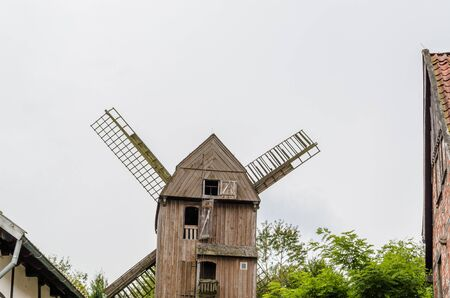 idyll: Typical Dutch wooden windmill. Stock Photo