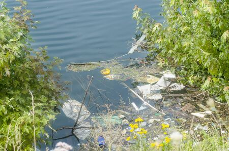 water wheel: Contaminated waters by careless disposal of packaging waste.