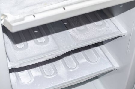 thawing: View of an empty freezer that will defrost. Stock Photo
