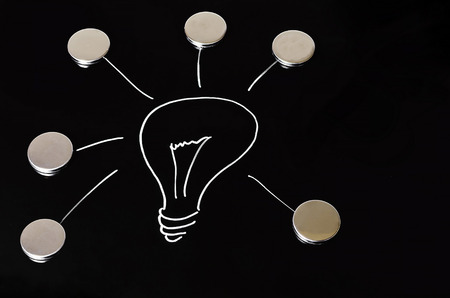 efficiently: A glowing light bulb on black background drawn. Symbol of ideas, concepts and creativity. Stock Photo