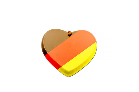 german culture: German flag be print on a heart. Stock Photo