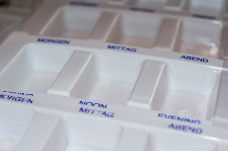 encapsulated: Medications box, for the sorting of pills and tablets.