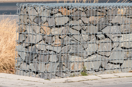 gabion mesh: Gabions, gabion for Wall, embankments, noise barrier, windbreak wall. Stock Photo