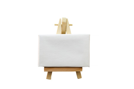 Miniature artist easel, isolated against a white background. photo