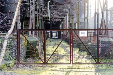 caved: Exterior of the entrance of an old factory building. Stock Photo