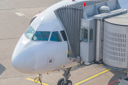 passenger aircraft: Passenger aircraft at the gate to prepare for the entrance of the passengers. Stock Photo